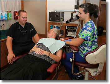 Dr. Wiles and a hygienist get acquainted with a new patient