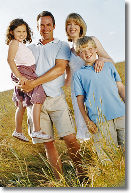 picture of a happy family hiking in a field